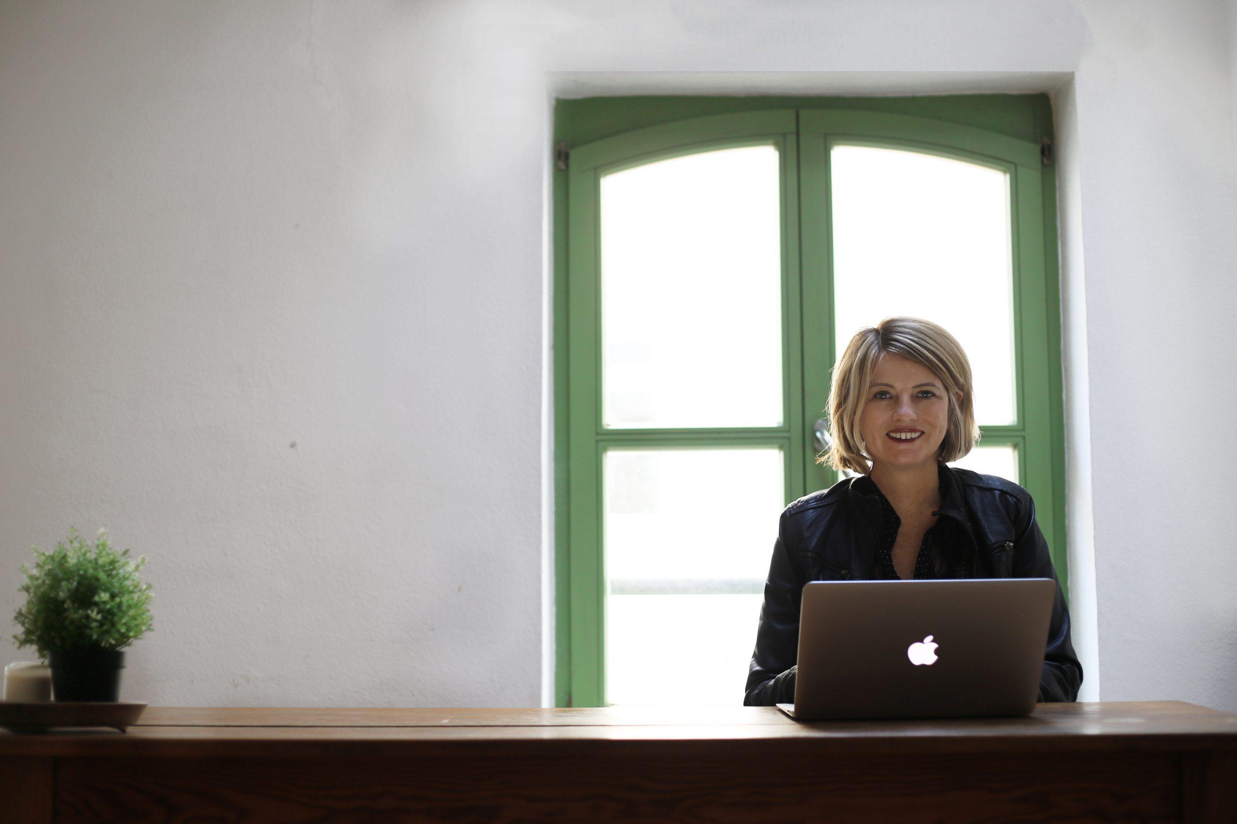 Lollie Barr, writer, at desk